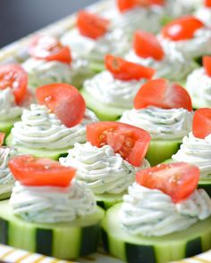 Dilly Cucumber Bites 4 large English cucumbers 1 pint grape tomatoes 1 (8 oz) block cream cheese, at room temperature 1 small (5.3 oz) container plain Greek yogurt 3 tbsp fresh dill, minced 1 tbsp powdered Ranch dressing mix (such as Hidden Valley)  Instructions  Report this ad  Slice cucumbers into rounds, about ½-inch thick. You can leave the skin on, peel them, or partially peel them for a striped look. Slice grape tomatoes in half (or quarters, if large) and set aside. In a bowl, combine…