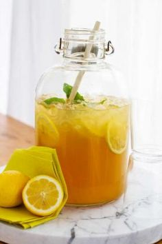 Summer cocktails that are pitcher perfect. I can imagine doing this for a house party and fill up the jar with a john daly mix -- sweet tea vodka & lemonade