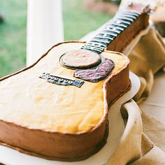 Guitar Shaped Groom's Cake | If music is a big part of the grooms life, show that off with an instrument cake.