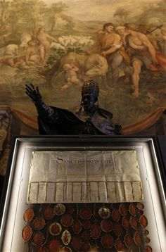 """Members of the English parliament wrote to Pope Clement VII in 1530 urging him to annul Henry VIII's marriage to his first wife so the king could marry Anne Boleyn, according to Vatican documents on display to the public for the first time.In the large parchment letter, hung with over 80 pendant seals attached with red silk ribbon, they alluded to the """"extreme remedies"""" they could pursue if their request were refused."""