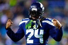 (Photos) NFL: Marshawn Lynch Is Gonna Rock These Sick $1,000 All Gold Cleats For NFC Championship- http://getmybuzzup.com/wp-content/uploads/2015/01/412018-thumb.png- http://getmybuzzup.com/nfl-marshawn-lynch-is-gonna/- By Joe Casey Money means nothing to Marshawn Lynch if it means it will keep him looking clean on the field, as he dropped over a thousand dollars for these custom, all gold cleats. The cleats were hand made by shoe-customizing guru Solesbysir and feature 24K g