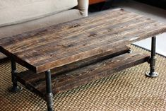 reclaimed wood coffee table with pipes and burnt wood -