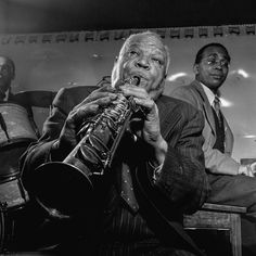 Sidney Bechet on soprano sax playing with Freddie Moore and Lloyd Phillips (in the background) at Jimmy Ryan's club in New York, NY in 1947.Photo by William P Gottlieb