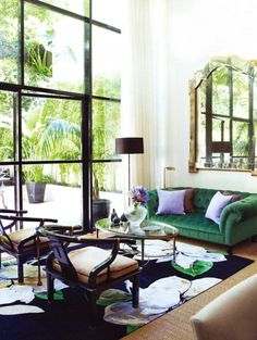 gorgeous living room, green couch, steel windows, mirror, rug