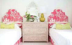 Charming guest room, fabric covered headboards in pink and white chinoiserie pagoda toile