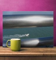 """Through The Silver Rails"" Photograph by Linda Prewer £35.00 https://displate.com/displate/149277   I captured this image whilst on a cruise ship. I noticed the silver highlights of the steel handrails and their framing of the small speed boat that was trying to race the Cruise Liner. Just above the top rail is the distant coastline of La Rochelle in France.  #metal #poster #sea #boat #art #photography"