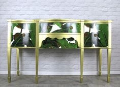 palm and gold upcycled sideboard