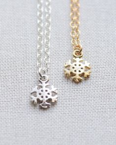 Tiny Snowflake Necklace in silver or gold by Olive Yew. The cutest winter accessory, perfect for any holiday occasion.