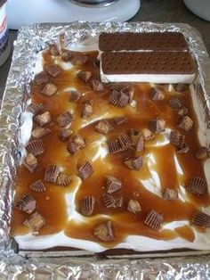 Ice Cream Sandwich Cake  24 ice cream sandwiches; 1 jar caramel sundae topping; 16 oz of cool whip; 1 bag of chocolate candy  Lay half of ice cream sandwiches in 9x13 pan. Top with half cool whip - half caramel - half candy. Another layer of sandwiches. Top with remaining cool whip, caramel & candy. Cover & freeze overnight.