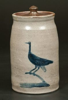 Very Rare Morgantown, WV Stoneware Canning Jar with  with Cobalt Decoration of a Crane on Branch, attributed to the Thompson Pottery, Morgantown, WV, circa 1870, tapered jar with recessed shoulder and flared rim, the front decorated with a brushed folk art design of a crane perched on a tree branch.