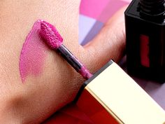 A swatch of Yves Saint Laurent Pourpre Preview Glossy Stain, a perfect purple gloss for 2014.