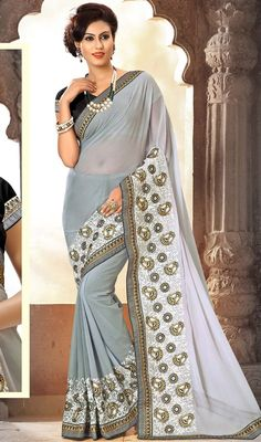 Plunge into elegance draping this gray color embroidered chiffon sari. Beautified with lace, resham and stones work. #chiffonsareeonline #buttaworksari #graycolorsarees