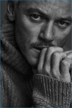 Appearing in a black & white image for Mr Porter's The Journal, Luke Evans dons a ribbed wool turtleneck sweater from Acne Studios.