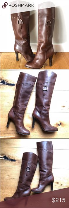 Ralph Lauren knee high heeled leather brown boot These Ralph Lauren Collection Purple Label equestrian style knee high boots come in a beautiful brown color. Slanted top with silver buckle / stirrup hardware detail and silver Ralph Lauren button initi Ralph Lauren Purple Label Shoes Heeled Boots