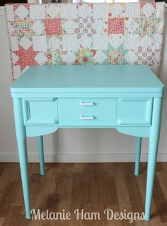 Painted old sewing machine cabinet. I am going to do this, would make a great side table.