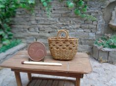 This tiny treasure is hand-woven with waxen linen thread on a wrapped floral wire base. This particular basket has one handle and is woven in to imitate dark rattan or wicker.Please note that as all are items are individually made, they may differ very slightly from the listing photo - this makes each one unique!Plates in photo are not included. If you have any questions, please do not hesitate to contact me! Not a toy, only for adult collectors! The brightness and shade of the colors may…