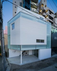 House in Nakameguro is a minimalist houseby Hayashijun Takashi Architects. The small home is located in the heart of the city. The peripheral site is undergoing construction of a three-story home. The architects wanted to display the furniture as an extension of the architecture, while providing an appropriate sense of scale in order to effectively utilize the space. http://leibal.com/architecture/house-nakameguro/