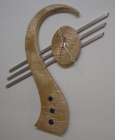 NEAT CLOCK OF CURLY MAPLE, ALUMINUM, AND GLASS.   IT IS ON DISPLAY AT THE NATIONAL INSTITUTE OF HEALTH IN WASHINGTON DC
