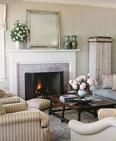 Stunning traditional design with cozy fireplace and large mirror above the mantle!  www.franksglass.com