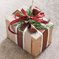 25 Stylish Gift Wrapping Ideas | Embellish with Rosemary | SouthernLiving.com - Rich with Christmas legend, rosemary is the herb of love and remembrance. Tuck a handful of fresh sprigs beneath the ribbon just before delivering packages.