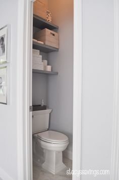 DIY Floating Shelves over Toilet in Water Closet for extra storage!  Amazing Real-Life Master Bathroom Renovation!  Carrara Marble, Square Chrome Fixtures, Grey Paint, Painted Cabinets, White Towels, PotteryBarn Lighting