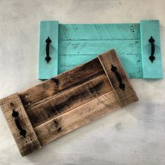 Cute, vintage and rustic pallet trays. Super easy to make too! Get a pallet, cut to size, paint then attach some cute handles available from hardware stores. Fairly cheap to make.
