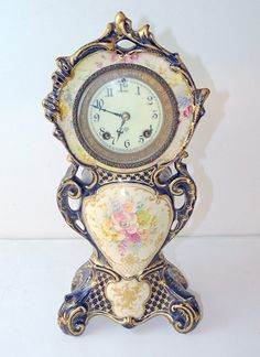 Ansonia Royal Bonn porcelain-case mantle clock with floral decoration on a cobalt background with gilt accents. on Nov 2015 Tabletop Clocks, Art Nouveau, Mantle Clock, Antique Clocks, Important Dates, Ticks, Vintage Watches, Deco, Porcelain