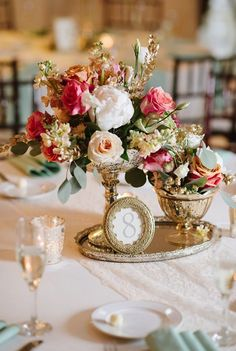 Photographer: Natalie Franke Photography; Elegant blush flowers gold decor wedding reception centerpiece;