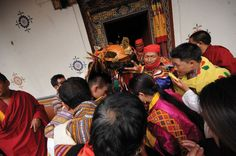 Getting blessed: Devotees receive blessing from a mask at the Thimphu drubchoe.