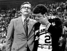Memphis State coach Gene Bartow comforts Larry Finch at the awards ceremony after the Tigers lost the NCAA final to UCLA in St. Louis in March 1973. Bartow died after a long fight with cancer on January 3.
