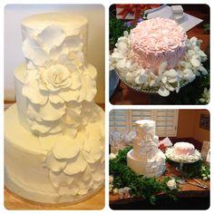 Wedding cake and one year celebration cake ~ White wedding cake ~ Cascading large white sugar rose (gum paste flower) ~ First birthday pink rosette cake.  Cakes by: Bella Baby Cakes