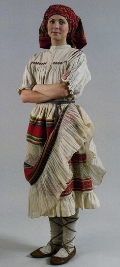 Russian traditional costume. Summer outfit of a peasant woman from Vologda Province, late 19th century.