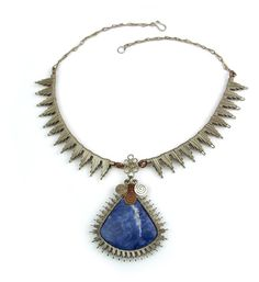 """Wire Wrapped Necklace """"Marcy."""" Eye-catching wire wrap necklace made with german silver and a splash of copper with a natural sodalite stone."""