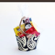 Halloween party favors in a cupcake wrapper.  Cute.