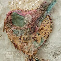 Milagro of Hope – Muslin, hand embroidery, vintage glass button by Pilar Isabel Pollock