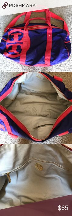 Tory Burch duffel bag PURPLE AND RED. Lighting in pictures make it look blue but this bag is purple. Roomy bag, can be a weekend bag. 2 zip pockets on the inside. Used. Still good condition. Tory Burch Bags Travel Bags