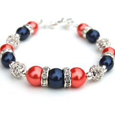 Jewelry for bridesmaids. navy and coral wedding | Navy and Coral Pearl Rhinestone Bracelet, Bridesmaids Gifts, I might have to enlist in the help of my future mother-in-law @Christina Childress Childress Holliday to help make something special for my bridesmaids (: