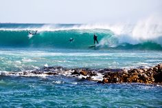 Surfing at Lighthouse Beach, North West Coast of Tasmania.  Image Credit: James Horan