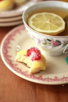 Lemon tea with raspberry lemon sweets.