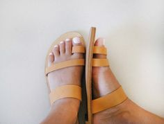 Greek Style Sandals made from Genuine Leather available in Various Colors.  (In the picture is the Tan color).    Sole made from mixture of leather to