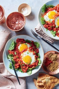 Our version of Eggs in Purgatory is a shakshuka-like dish in which fiery harissa paste and heady spices slowly infuse a rich tomato sauce where eggs gently poach. Perfect for a hearty breakfast or easy dinner. Serve with warm whole-wheat pita. Crock Pot Slow Cooker, Slow Cooker Recipes, Crockpot Recipes, Cooking Recipes, Cooking Tips, Healthy Dinner Recipes, Breakfast Recipes, Clean Breakfast, Paleo Breakfast
