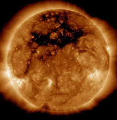 A photo of the sun from NASA's orbiting Solar Dynamics Observatory reveals an enormous coronal hole %u2014 a gap in the sun's outer layer and magnetic field the size of 50 Earths. The image was captured Oct
