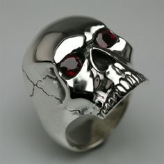 Skull ring in silver & brilliant cut rubies