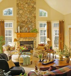 Floor-to-Ceiling Stone Fireplace - Greenery is a good addition to the mantel.
