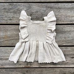 The ruffle top is knitted in stockinette stitch from the bottom up.
