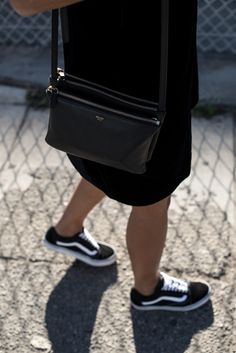 storm wears céline trio bag in black with vans old skool sneaker and black velvet dress los angeles theadorabletwo