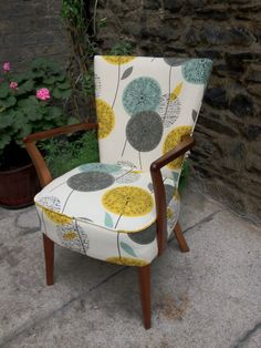 Upholstery fabrics. I love the design of the chair (mid-century modern) and the pattern which is a bit MCM and contemporary.