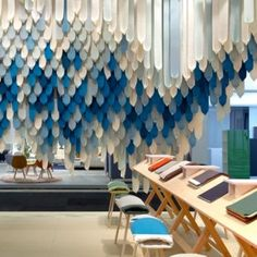 London-based design duo Raw Edges arranged hundreds of fabric ribbons around the edge of their display stand for Danish textile manufacturer Kvadrat at this year's Stockholm Design Week. Commercial Design, Commercial Interiors, Stage Design, Event Design, Stockholm Design, Ribbon Display, Fabric Display, Fabric Decor, Interior Architecture