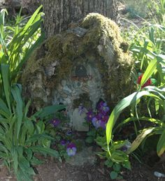 So, what do you do with an old tree stump you can't get rid of?  Well, I took mine and I made it into a little fairy house - with some mortar and stones, moss and bark.  It was sort of tucked into my garden - I had no way to rip stump out - so.... kinda made lemonade from a big fat lemon!