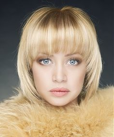 A short blonde straight coloured multi-tonal hairstyle by Web Collections